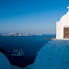 Santorini - Fira : Fira is the capital of Santorini, Greece, and the most important of all villages.  The town of Fira is a typical Cycladic village made of charming white houses with blue windows and doors, separated from each other by small paved streets. Many of its beautiful buildings were constructed back in the times of the Venetian invasion, including some blue domed churches and sun-bathed verandas
